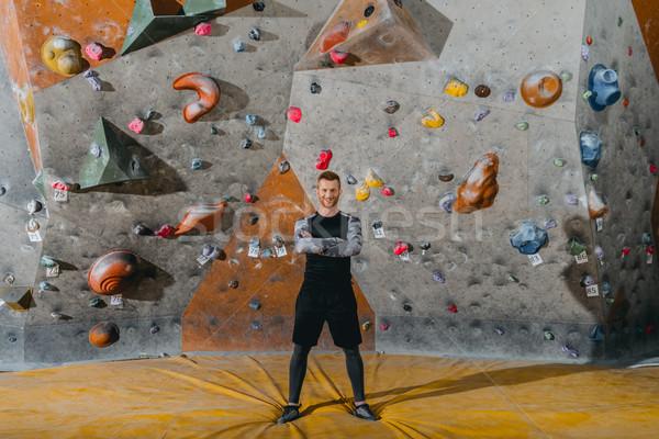 молодым человеком скалолазания стены выстрел позируют Сток-фото © LightFieldStudios