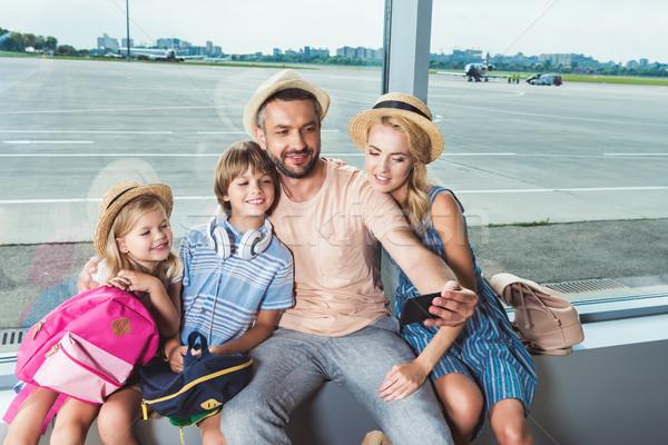 happy family taking selfie in airport Stock photo © LightFieldStudios