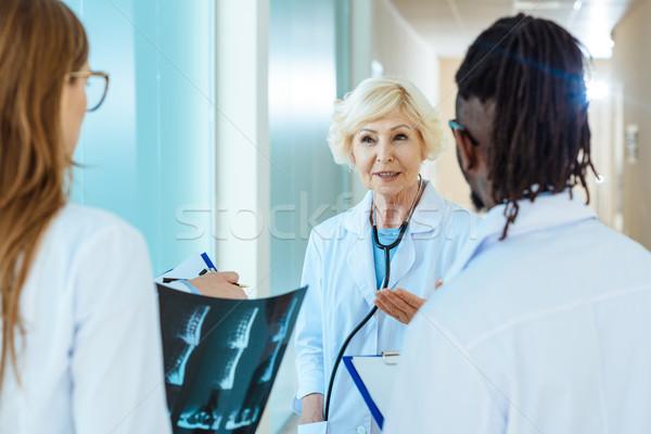 Senior doctor teaching interns Stock photo © LightFieldStudios
