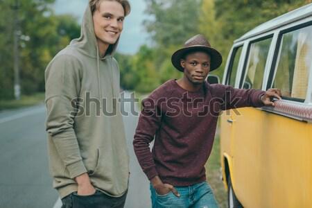 friends traveling by retro minivan Stock photo © LightFieldStudios