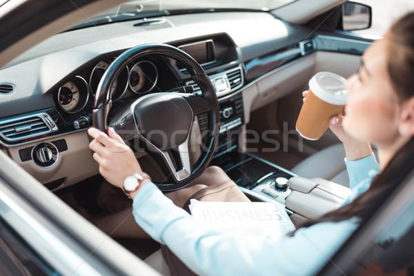 Stock photo: woman driving car