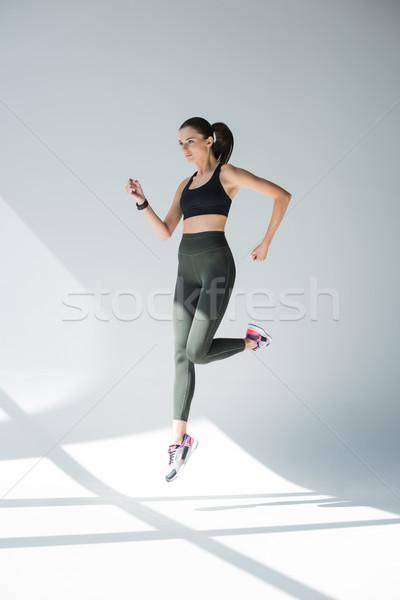 Ugrik lány sportruha teljes alakos kilátás sportos Stock fotó © LightFieldStudios