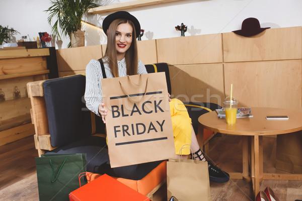 Panier black friday belle femme symbole Shopping Photo stock © LightFieldStudios