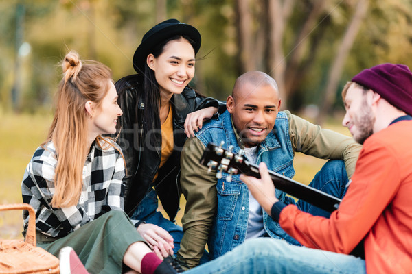 multicultural friends resting in park Stock photo © LightFieldStudios