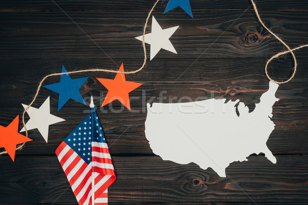 top view of arranged american flags, piece of map and stars on wooden surface, presidents day celebr Stock photo © LightFieldStudios