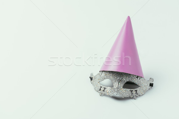 close up view of masquerade mask and party cone isolated on grey Stock photo © LightFieldStudios