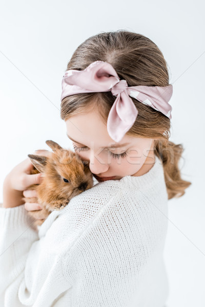 girl holding adorable furry rabbit isolated on white Stock photo © LightFieldStudios