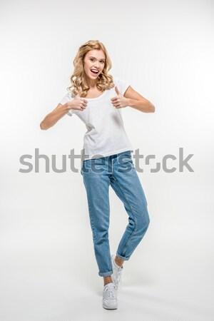 Woman showing thumbs up  Stock photo © LightFieldStudios