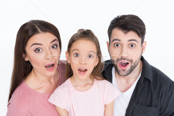 Surprised young family looking at camera on white Stock photo © LightFieldStudios
