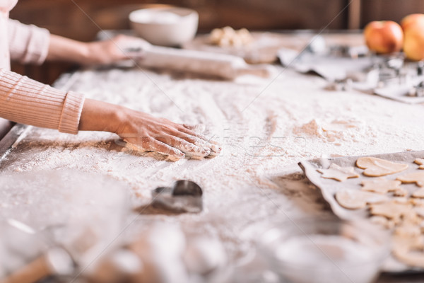 'Partial view of woman kneading dough at kitchen table Stock photo © LightFieldStudios