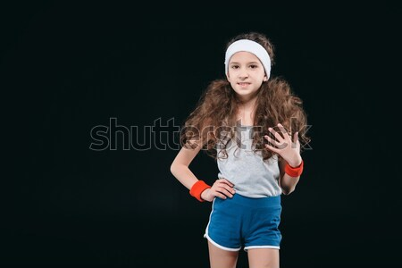 Stock photo: girl posing in sportswear isolated on black. 12 year old kids, children sport concept