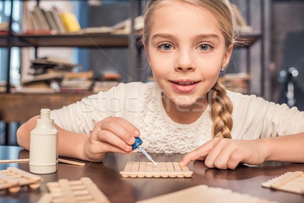Little girl handcrafting Stock photo © LightFieldStudios