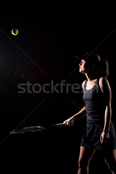 Női teniszező koncentrált labda ütő fekete Stock fotó © LightFieldStudios