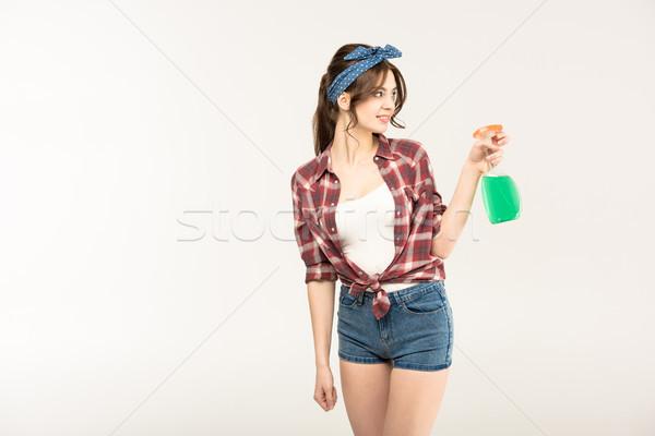 Genç kadın sprey şişe gülen genç ev kadını Stok fotoğraf © LightFieldStudios