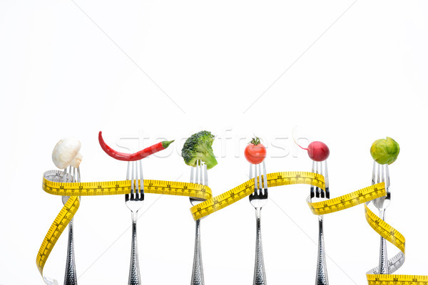 fresh vegetables on forks with measuring tape isolated on white, healthy living concept Stock photo © LightFieldStudios