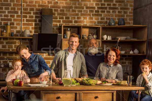 family cooking dinner together Stock photo © LightFieldStudios
