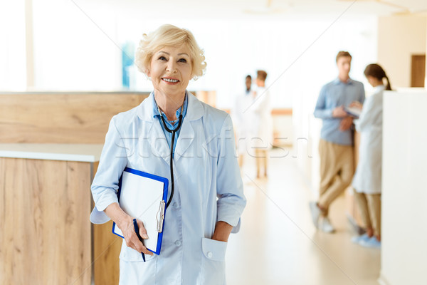 Senior doctor in hospital hall Stock photo © LightFieldStudios