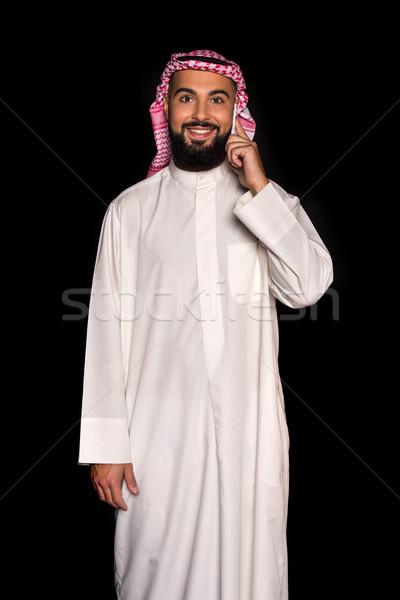 Moslim man praten telefoon glimlachend geïsoleerd Stockfoto © LightFieldStudios