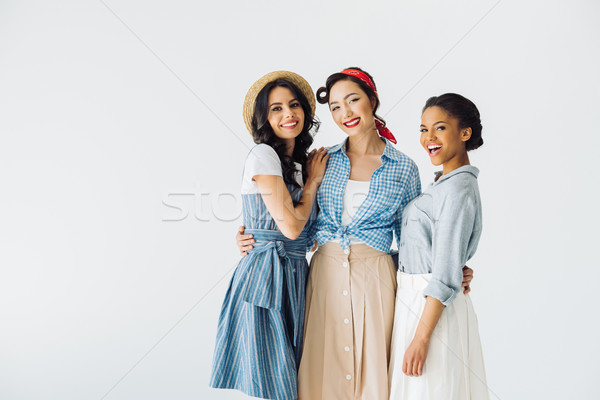 multicultural women in retro clothing Stock photo © LightFieldStudios