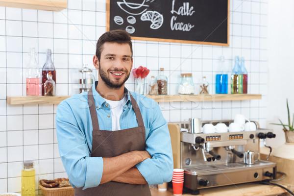 Glimlachend cafe eigenaar knap jonge schort Stockfoto © LightFieldStudios