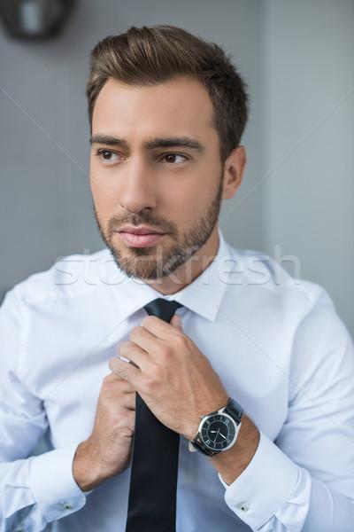 businessman straightening tie  Stock photo © LightFieldStudios