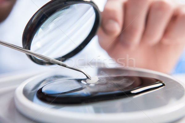Sample throungh magnifying glass  Stock photo © LightFieldStudios