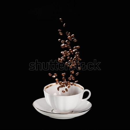 Koffiebonen vallen beker geïsoleerd zwarte koffie bonen Stockfoto © LightFieldStudios