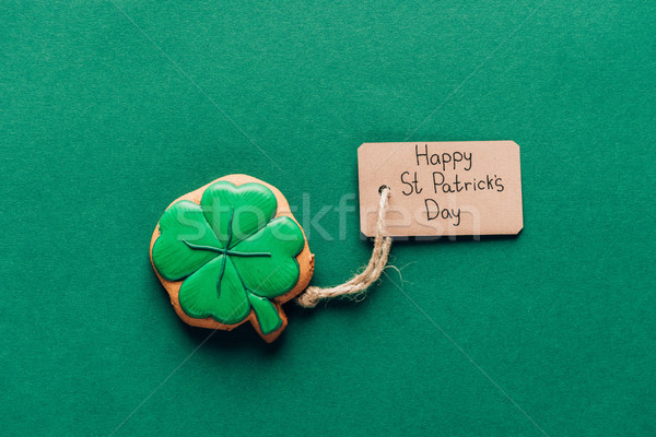 top view of icing cookie in shape of shamrock on green, st patricks day concept Stock photo © LightFieldStudios