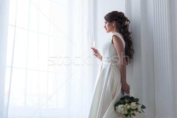 брюнетка невеста платье стекла шампанского Сток-фото © LightFieldStudios