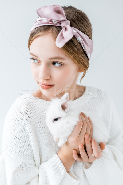 adorable child holding furry white rabbit and looking away isolated on white Stock photo © LightFieldStudios