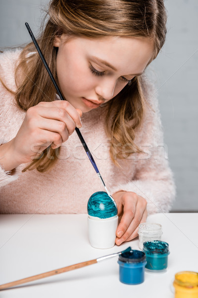adorable focused girl painting easter egg Stock photo © LightFieldStudios