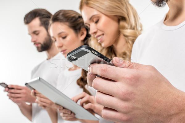 Friends using digital devices Stock photo © LightFieldStudios