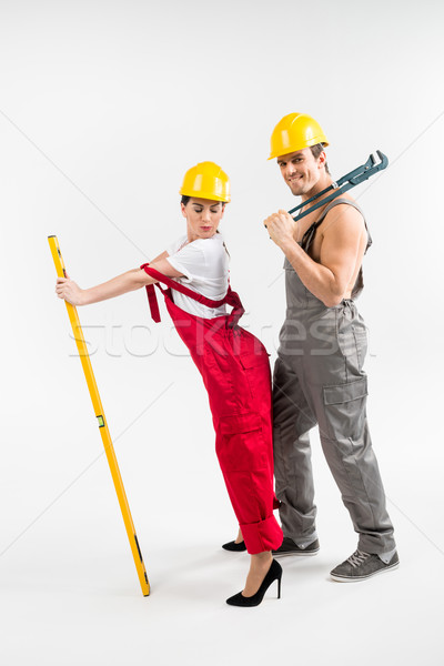 Male and female builders posing Stock photo © LightFieldStudios