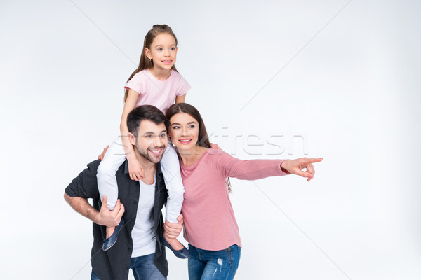 Happy young family with one child smiling and looking away on white Stock photo © LightFieldStudios