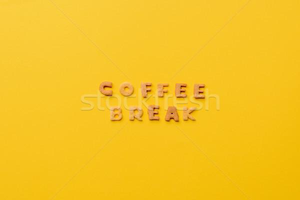 coffee break lettering made of crisps isolated on orange Stock photo © LightFieldStudios