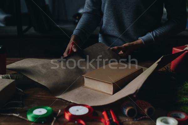 женщину упаковка книга Рождества подарок выстрел Сток-фото © LightFieldStudios