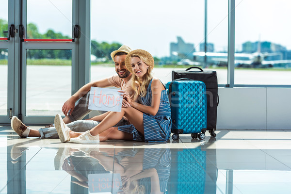 couple with card in airport Stock photo © LightFieldStudios