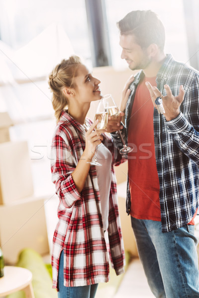 couple drinking champagne in new house Stock photo © LightFieldStudios