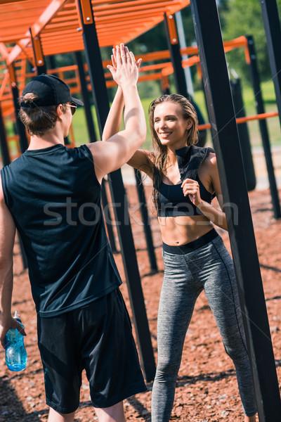 Nő pacsi edző mosolygó nő sportruha képzés Stock fotó © LightFieldStudios
