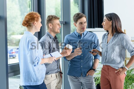 men drinking coffee in cafe Stock photo © LightFieldStudios