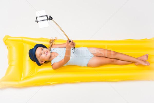 Gyermek elvesz úszik matrac imádnivaló mosolyog Stock fotó © LightFieldStudios