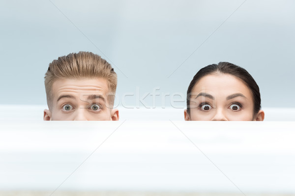 partial view of scared scientists looking out behind table in lab Stock photo © LightFieldStudios