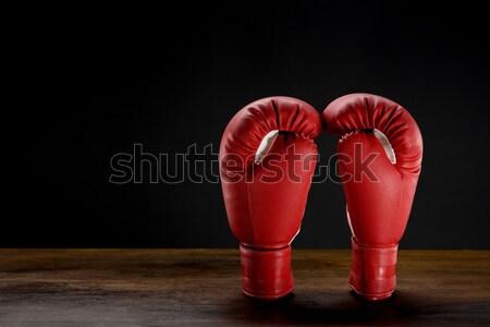 Vermelho luvas de boxe tiro escuro Foto stock © LightFieldStudios