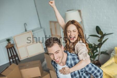girl sitting in box and waving at camera Stock photo © LightFieldStudios
