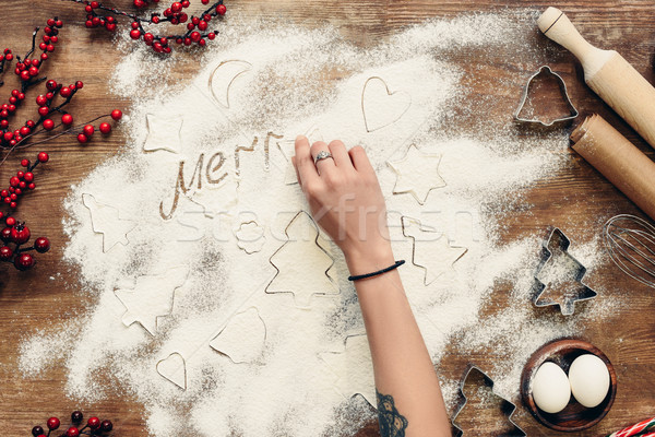 merry christmas inscription in flour Stock photo © LightFieldStudios