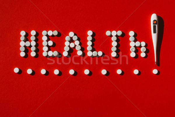 Szó egészség tabletták hőmérő felső kilátás Stock fotó © LightFieldStudios