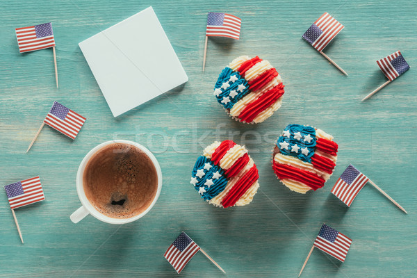 flat lay with arranged cupcakes, cup of coffee and american flags on wooden tabletop, presidents day Stock photo © LightFieldStudios