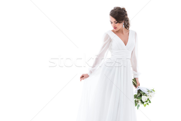 魅力的な 花嫁 ポーズ 白いドレス 結婚式のブーケ 孤立した ストックフォト © LightFieldStudios