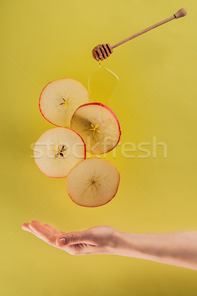 partial view of female hand and levitating pieces of apple with honey Stock photo © LightFieldStudios