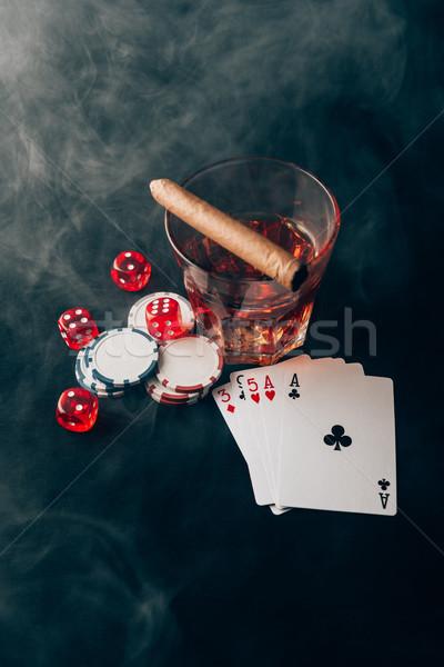 Hazárdjáték whiskey kaszinó asztal kártyák kocka Stock fotó © LightFieldStudios